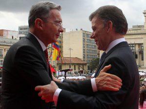 Juan Manuel Santos und Álvaro Uribe